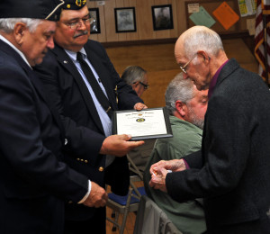 WWII Army veteran of the ETO, Harold Sprague receives his awards from Chaplain Ray Antunes and Service Officer Doug Dowling
