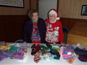 Long time Auxiliary members Phyllis and Muriel man the mitten table