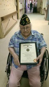 Dot shows off her Honor Certificate to recognize her WWII service in the US Navy.