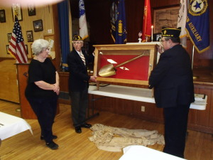 Commander Ed Gosnell and Chaplain Ray Antunes unveil display case with golden shovel for Lois Tenan.