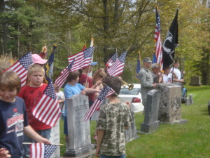 Cherryfield children and marchers gather at Pine Grove Cemetery for the wreath laying ceremony.