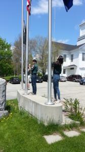 Our Venture Scouts raise Flags.